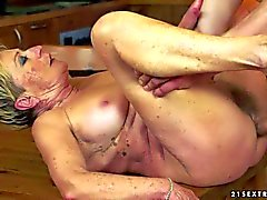 Short haired granny gets her hairy twat boned on table