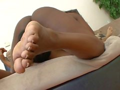 Naughty black whore gets her feet licked and worshiped poolside
