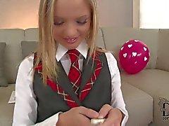 Blonde schoolgirl Vanda in uniform polishes her twat