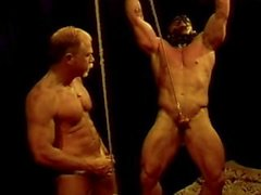Bodybuilder ball squeezing and punching, a classic video of mine.