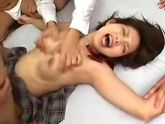 Sweet Oriental schoolgirl has a group of boys sharing her h