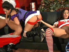 Latina babes with big boobs fuck Santa and his helper