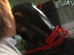 Bondaged Jap slut in latex suit
