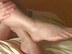 Naked girl puts on panty hose
