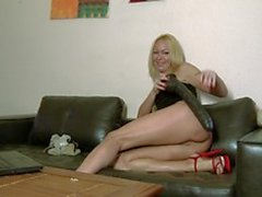 Lovely MILF blonde Tamara Dix doing a strip on her webcam
