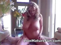 Mature extremely huge breasted blonde lady exposed