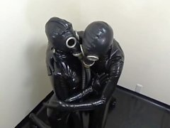 japanese latex couple in latex and gas mask