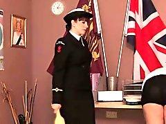 Police dominatrix paddles colleague over desk