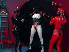 Rubber clad trio dominatrix action