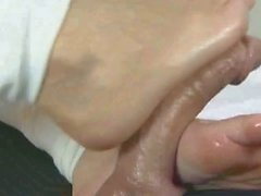 Sexy blonde does a footjob