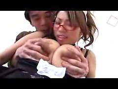 Voluptuous Japanese babe has a horny boy caressing her huge
