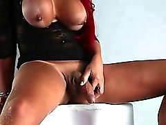 Tall redhead tranny jerks off her huge dick and cums