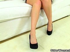 British milf Heidi slides a finger up her fanny