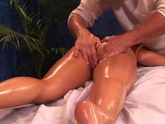 Oiled girl massages a dick with her cunt