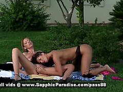 Jaquelin and Isabella brunette and redhead lesbian couple touching and undressing
