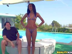 Petite hot ass Isabella rides on Jay by the pool