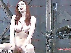 Tied up girl waits with anticipation of her next punishment