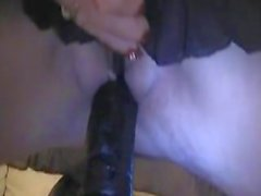 Huge Black Dildo up her ready pussy . . .