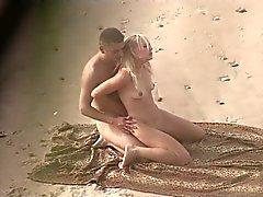 Voyeur on public beach. Hot young couple sex2