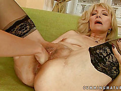 This nympho cougar acquires her hirsute cum-hole pummeled with a large fist