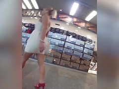 blonde miniskirt legs shopping