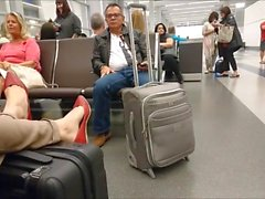 candid red flats in airport and dangling in plane