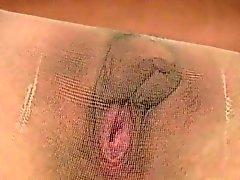 Den sexiga agerar i svart pantyhose