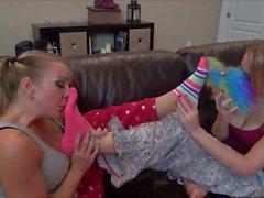 Lesbians sniffing feet