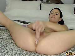 Ebon babe masturbating with her toys