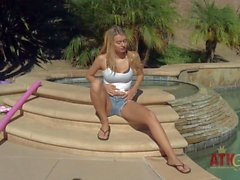 Natalia Starr bares her natural tits by the pool