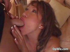 Horny MILF with gigantic tits sucks