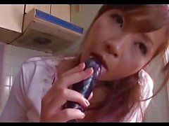 Busty Milf Masturbating With Banana And Vibrator On The Desk In The Kitchen