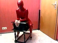 Red Bondage Suit Sub Girl