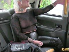 Tattooed chick gains cumshot in the cab