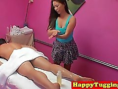 Asian masseuse jerking and riding client cock