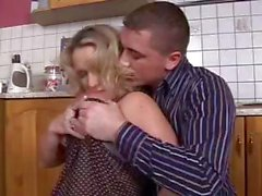 Busty blonde mom seduces the boy next door and gets nailed