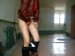Russian girl pulls down her panties in a building