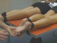 Two Secretary Tied Up Feet Ticke