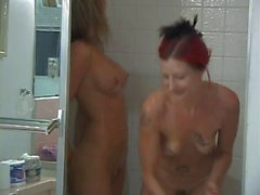 Horny lesbian bitches in the bathroom