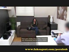 Brunette on the casting couch gets busy with mouth and pussy