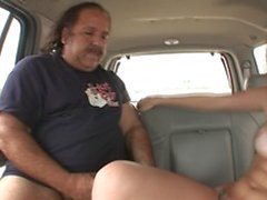 Legendary star Ron Jeremy gets to fuck a sexy brunette in a van