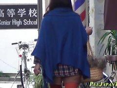 Asians pee flood alleyway