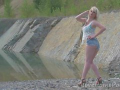 Hot blonde with big tits enjoys the lake