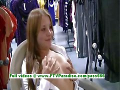 Jacky cute redhead babe posing and flashing tits in public