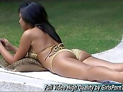 gorgeous brunette tickles her clit while sunbathing