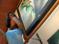 Tattooed brunette Alby Rydes dressed in blue flaunts her booty