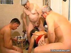 Old slut takes three cocks