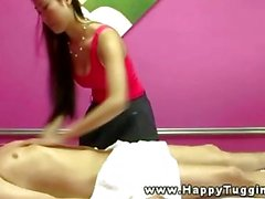 Asian masseuse rubbing her client down