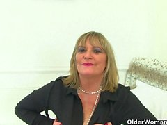 Big titted and British milf Sammy Sanders plays with dildo