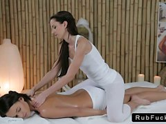 Brunette lesbian gets breasts massage by masseuse